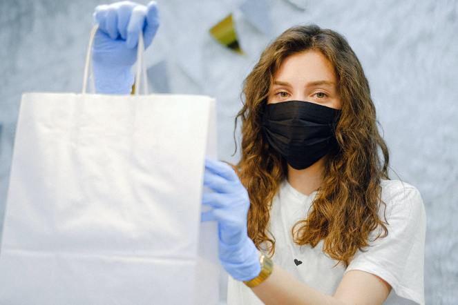 woman-with-face-mask-and-latex-gloves-holding-a-shopping-bag-4226269